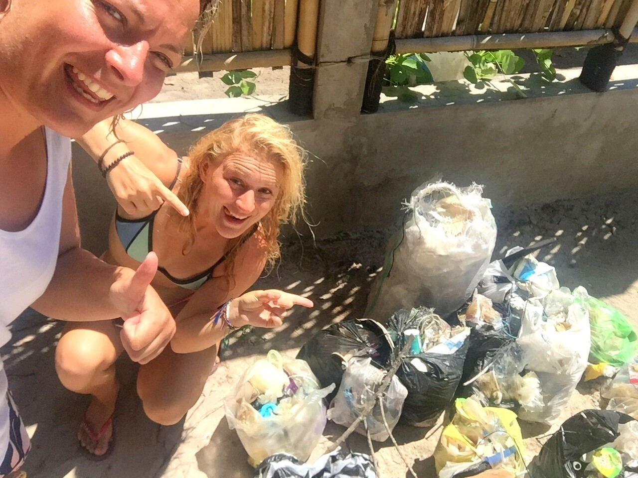 Beach cleanup against plastic pollution of oceans